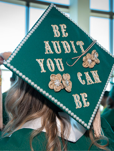 "graduate mortar board with words ""be audit you can be"""