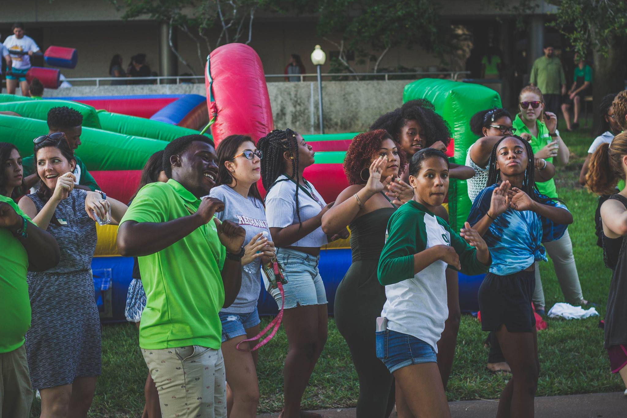 Students outdoors dancing in sync during USF week